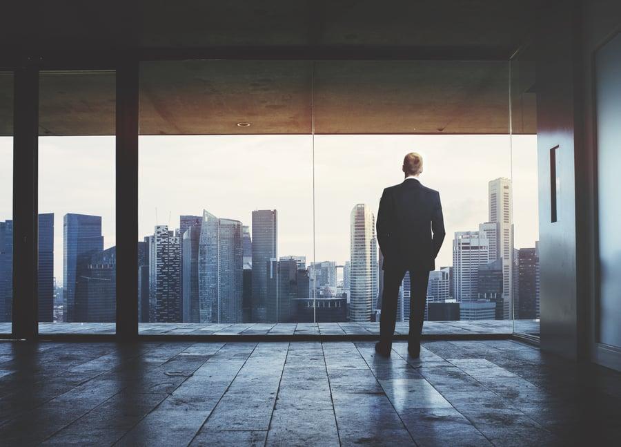 bigstock-Businessman-looking-at-city-59349905